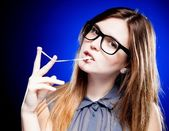 Portrait of strict young woman with nerd glasses and chewing gum — Stock Photo