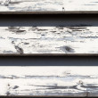 Stockfoto: Peeling Paint on old wooden siding, texture