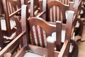 Stacked wooden classic chairs — Stock Photo
