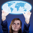 Woman's hands pushing world map button, touch screen — Stock Photo #24002325