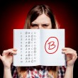 School grade of exam and disappointed girl — Stock Photo