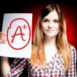 Stockfoto: Perfect school grade A plus of exam and happy girl