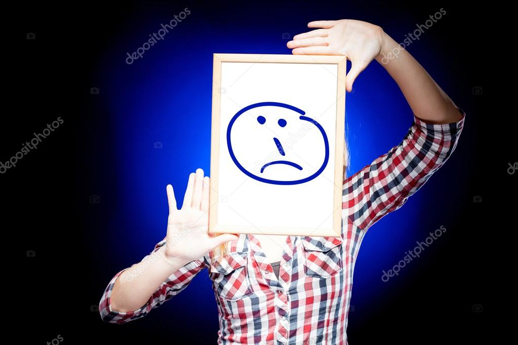 Blue Sad Face Emoticon Woman Showing a Sad Emoticon in Front of Face