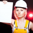 Young architect woman construction worker, empty poster - Stock Photo