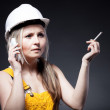 Young architect woman construction worker, cigarette and phone — Stock Photo #25209275
