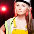 Young architect woman construction worker, glowing lights — Zdjęcie stockowe