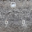 Old stone castle wall texture, cannon windows — Stock Photo