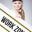 Work zone sign placed on information board, worker woman — Stock Photo