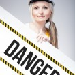 Danger sign placed on information board, worker woman — Stock Photo