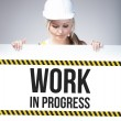 Work in progress sign on information poster, worker woman — Foto Stock