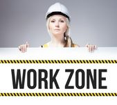 Worker holding work zone sign on information board — Stock Photo
