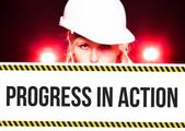 Worker holding progress in action sign on information board — Stock Photo