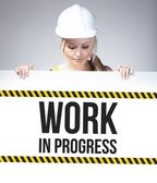 Work in progress sign on information poster, worker woman — Stock Photo