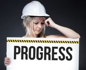 Progress sign on information board, thinking worker — Stock Photo