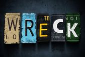 Wreck word on vintage car license plates, concept sign — Stock Photo