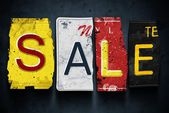 Sale word on vintage car license plates, concept sign — Stock Photo