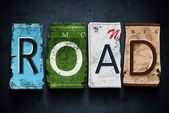 Road word on vintage car license plates, concept sign — Stock Photo