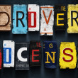 Driver license word on vintage car number plates, concept sign — Stock Photo