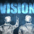 Stock Photo: Two successful businessman showing vision, business concept