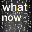 What now on chalk board with many question marks — Stock Photo #28156987