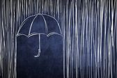 Umbrella and rain, conceptual sketch on chalkboard — Stock Photo