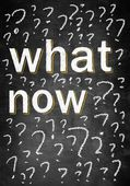 What now on chalk board with many question marks — Stock Photo