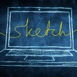 Netbook computer screen internet concept with sketch word — Stock Photo