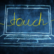 Sketch netbook computer screen internet concept with touch word — Stock Photo #28592351