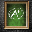 A plus grade chalkboard in old wooden frame — Stock Photo