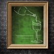 Bottle and glass of wine chalkboard in old wooden frame — Stock Photo