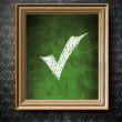 Check mark symbol chalkboard in old wooden frame — Stock Photo