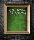 Kucharze specjalne z tablicy miejsce w starej drewnianej ramie — Zdjęcie stockowe