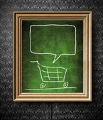 Shopping cart with copy-space chalkboard in old wooden frame — Stock Photo
