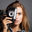 Young photographer taking pictures with old camera — Stock Photo