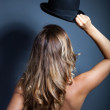 Naked womstanding back wears hat on head — Stock Photo #31795781