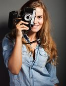 Silly photographer woman taking pictures old camera — Stock Photo