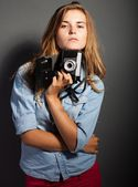 Thinking photographer woman with old camera — Stock Photo