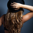 Sexy womin lingerie wears hat on head — Stock Photo #31928291