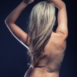 Beautiful naked woman with blond hair in back view — Stock Photo #32115055