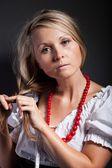 Folk woman in folklore clothes braiding a plait — Stock Photo