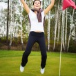 Overjoyed and smiling woman golf player in winner pose — Zdjęcie stockowe