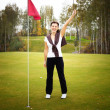 Overjoyed and smiling woman golf player in winner pose — Stock Photo