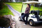 Woman standing near golf cart car and looking at view — Stok fotoğraf