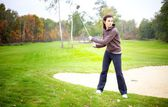 Woman player training on golf course, preparing to shot — Stock Photo