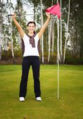 Happy and smiling woman golf player in winner pose — Stock Photo
