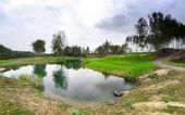Golf course landscape with lake — Stock Photo