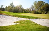 Golf course landscape view, field and sand bunker — Stock Photo