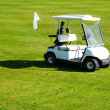 Stock Photo: Golf-cart car on golf course green