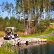 Стоковое фото: Golf-cart car on field of golf course