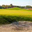 Stock Photo: Green of golf course with cup and bunkers